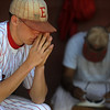 Easton High's Dant Foos, left, lowers his head as he and his teammates show their disappointment after losing to Holy Family in the 3A Colorado State Baseball Championship game at Butch Butler Field in Greeley, Colo. on Saturday 05/29/10.  The game was called after the 5th inning when Holy Family went up 11-1 to clinch the victory.  (SPECIAL TO THE POST/ MATT MCCLAIN)