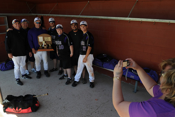 Holy Family coaches pose for a photograph with their championship trophy after defeating Eaton High in the 3A Colorado State Baseball Championship game at Butch Butler Field in Greeley, Colo. on Saturday 05/29/10.  The game was called after the 5th inning when Holy Family went up 11-1 to clinch the victory.  (SPECIAL TO THE POST/ MATT MCCLAIN)