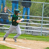 Nashoba's Ethan Sprague watches his hit as he takes off down the first base line. Nashoba Valley Voice/Ed Niser