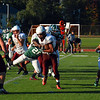 Ayer Shirley quarterback Daniel Goldstein stiff-arms a Burncoat defender during Saturday's loss.<br /> NASHOBA PUBLISHING/ED NISER