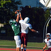 Ayer Shirley defensive back Alex Walker attempts to swat the ball out of the hands of Burncoat wide receiver Nathan Dubay, who caught the ball for a touchdown in the first quarter.<br /> NASHOBA PUBLISHING/ED NISER