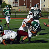 Ayer Shirley junior defensive lineman Ryan Catino strips Burncoat's Juan Carlo Nunez.<br /> NASHOBA PUBLISHING/ED NISER