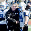 Coach of the year: Hoosick Falls coach Ron Jones consoles Charles Hodge after being defeated by Rye Neck 14-0 during Class C high school state semifinal football action Saturday, November 23, 2013 at Dietz Stadium in Kingston, N.Y.(J.S. Carras - The Record).