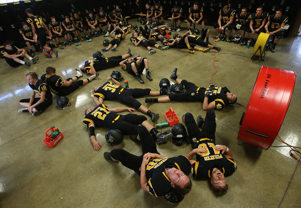 Black River football players try to rest and stay cool prior to their game against McDonald. AARON JOSEFCZYK/GAZETTE