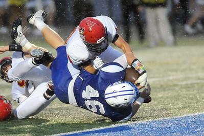 Brunswick's Alex Gillespie dives past Brecksville-Broadview Heights Zach Venesile for a touchdown in the second quarter. (JUDD SMERGLIA / GAZETTE)