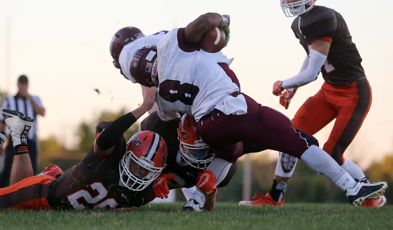 Buckeye Brennan Thiergartner and Dominic Monaco bring down Rocky River running back Dameon Crawford during the second quarter. Aaron Josefczyk/Gazette
