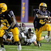 #67 Raiquan Ward leads Maurice Jones. Burnt Hills at Troy Class-A football, September 13/2013, (Mike McMahon/The Record)