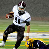 Burnt Hills QB Danny Maynard eludes a tackle . at Troy Class-A football, September 13/2013, (Mike McMahon/The Record)