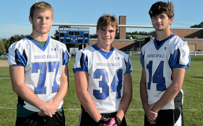 Left to right, Derek Bird, Brandon Hodges and Levi Brewster. Hoosick Falls Football practice. (Mike McMahon / The Record) 08/23/13