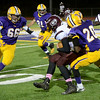 Mike McMahon - The Record, Ryan Barnes closes in as Maurice Jones ties up Austin Flynn in first quarter of the Gloversville at Troy Class-A football sectionals Friday, October 25. 2013.