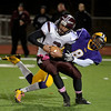 Mike McMahon - The Record, Troy's Alex Little pulls down Gloverville's QB Asa Barhill in  First quarter of the Gloversville at Troy Class-A football sectionals Friday, October 25. 2013.