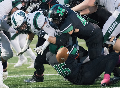 Joey Esker, 46, of Highland creates a fumble that is recovered by the hornets during Friday nights game against Aurora.  (Kyle Lanzer/Special the Gazette)