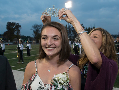 Delaney Geiger, 17, a Highland High School Senior is crowned the 2017 Homecoming Queen by her mother Shari before Friday nights game against Aurora.  (Kyle Lanzer/Special the Gazette)