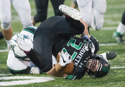 Connor Vomero, 27, of Highland recovers the fumble in the 1st quarter against Aurora during Friday nights game against Aurora.  (Kyle Lanzer/Special the Gazette)