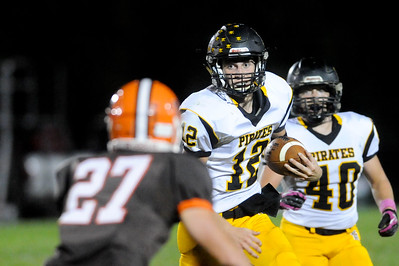 Black River's Mike Hazlett looks for running room around Buckeye's Dennis Matson in the second quarter Friday night at Buckeye. JUDD SMERGLIA / GAZETTE