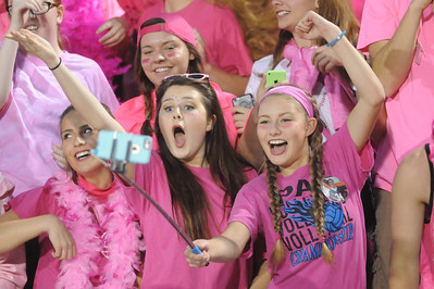 Buckeye Seniors Shannon Storch (left) and Tori Avallone (right) uses a selfie stick and cell phone to capture their celebration during the first half Friday night. JUDD SMERGLIA / GAZETTE