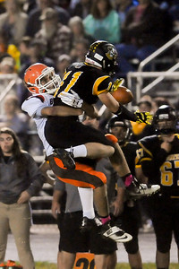 Buckeye's Patrick Caniglia breaks up a pass intended for Black River's Riley Gibbs in the second quarter Friday night at Black River High School. JUDD SMERGLIA / GAZETTE