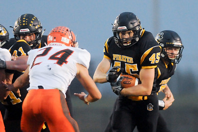 Black River's Jake Campbell runs straight at Buckeye's Austin Bir first quarter Friday night at Black River High School. JUDD SMERGLIA / GAZETTE