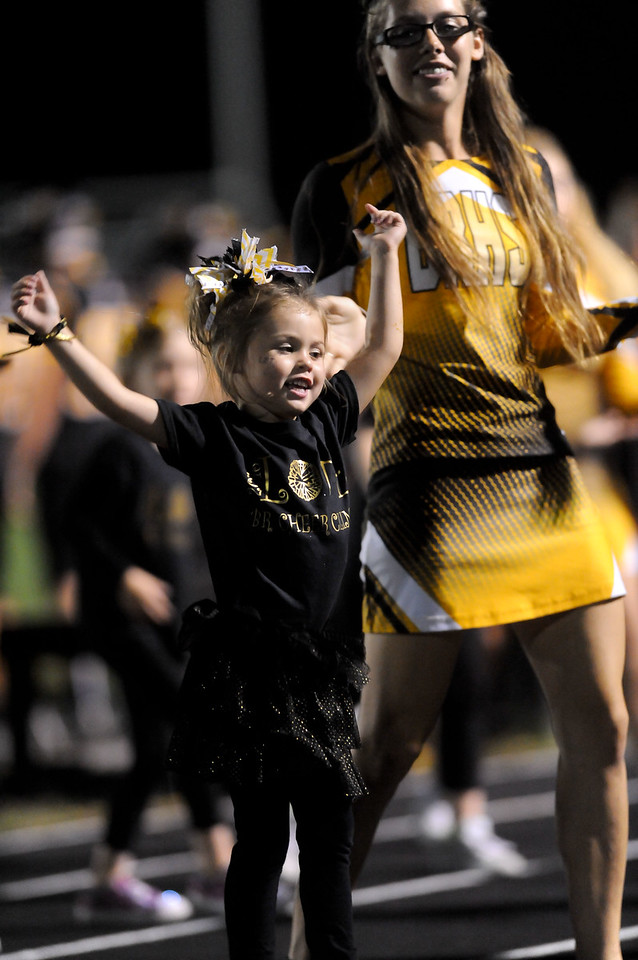 Black River Senior Cheerleader, Autumn Lampshire, cheers along side Riley Ford, age 4, who got to cheer during the first half of the game with the Black River Cheerleaders as a part of the cheer leading clinic. (JUDD SMERGLIA / GAZETTE)
