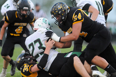 Black River's Cory Hamilton (#30) and Curtis Roupe (#54) bring down Columbia's Brandon Coleman in the first quarter. (JUDD SMERGLIA / GAZETTE)