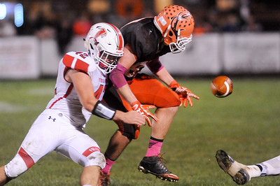 Fireland's Luke Peterson strips the ball out of the hands of Buckeye's Logan Schulz in the second quarter Friday night at Buckeye High School. JUDD SMERGLIA / GAZETTE