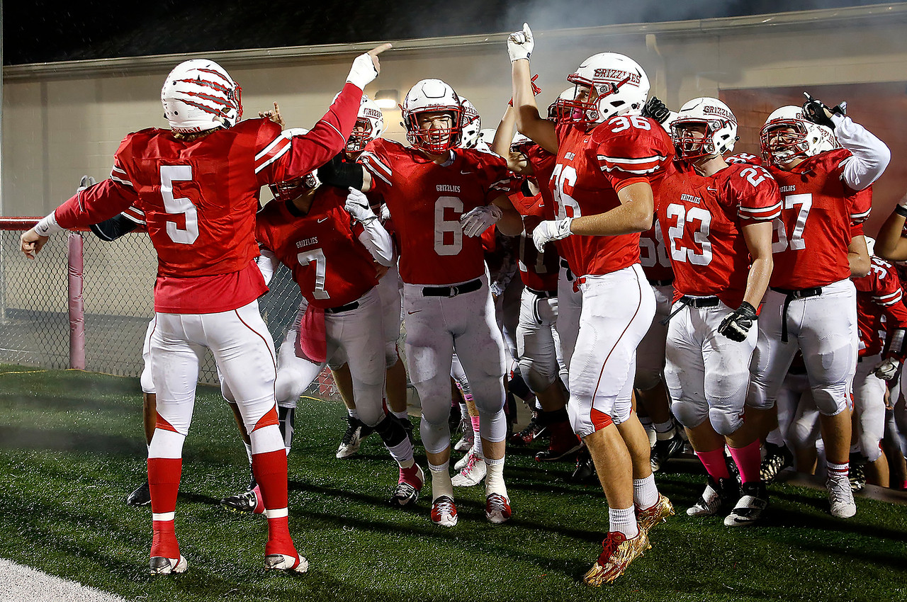 Wadsworth's Craig Palidar (5) leads the Grizzlies onto the field against Hudson. (RON SCHWANE / GAZETTE)