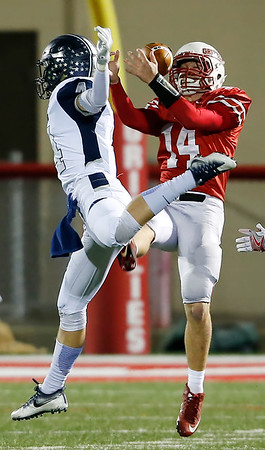 Wadsworth's Brock Snowball (14) intercepts a pass against Hudson's Greg Mailey during the second quarter. (RON SCHWANE / GAZETTE)