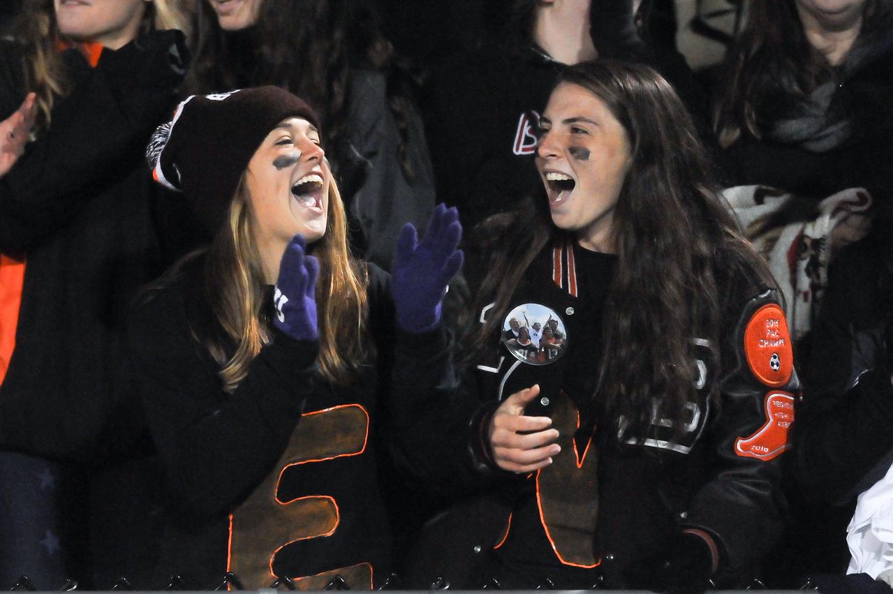 Buckeye High School Seniors Sophia Barnes (left) and Olivia Hartley (right) cheer for the Bucks during the game Friday night. JUDD SMERGLIA / GAZETTE