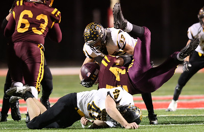 Black River's Jacob Campbell (45) and Spencer Constable take down South Range running back Peyton Remish in the first quarter. Aaron Josefczyk / Gazette
