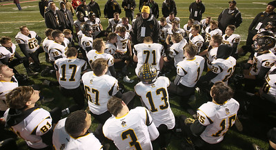 Black River head coach Al Young talks with players after the Pirates were defeated by South Range High School in their Regional Final football game. Aaron Josefczyk / Gazette
