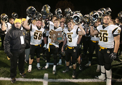 Black River's head coach Al Young stands with his players as they hold up the Division 5 Regional runner up trophy final game to South Range. Aaron Josefczyk / Gazette
