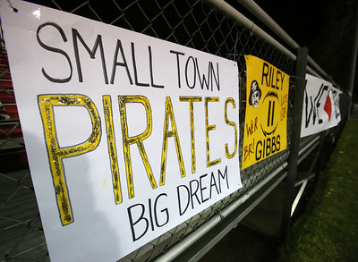 Black River signs line the sideline fence during the Pirates' Regional Final playoff game against South Range. Aaron Josefczyk / Gazette