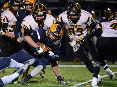 Black River's Joey Duche (76) and Trevor Scott (53) tackle Wickliffe's Nick Fenton (6) in the first quarter of Friday's playoff game at North Ridgeville High School. Black River won 44-6. (NICK CAMMETT/GAZETTE)