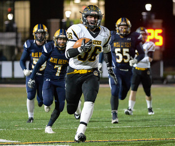 Black River's Travis Sexton (36) carries the ball downfield in the third quarter of Friday's playoff game against Wickliffe at North Ridgeville High School. Black River won 44-6. (NICK CAMMETT/GAZETTE)