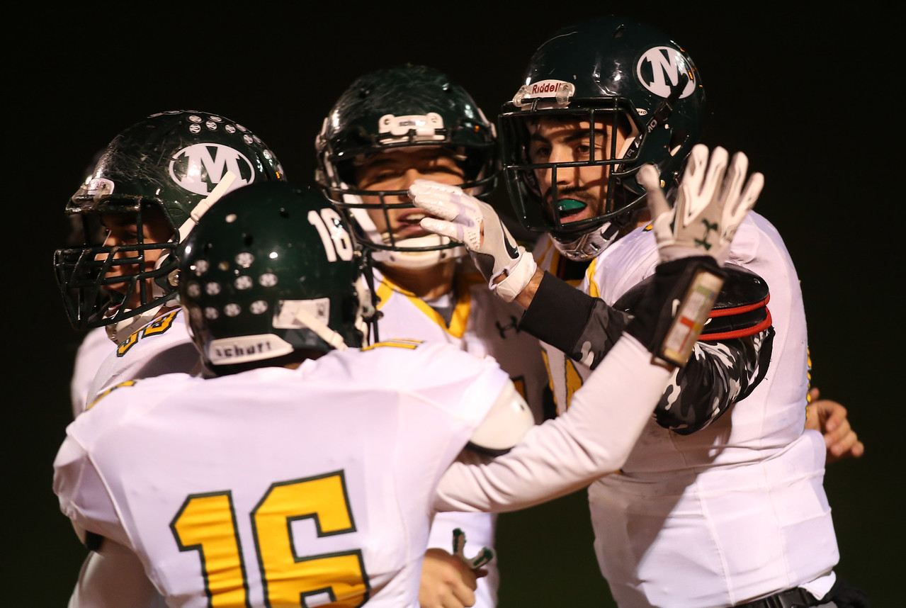 Medinas' Jimmy Daw celebrates with teammates after scoring on a pass play late in the second quarter against Olentangy Liberty in Mansfield. AARON JOSEFCZYK / GAZETTE