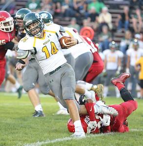 Medina's Jiimmy Daw tries to escape Elyria's linebacker Zack Mason's grip at Elyria High. RAY RIEDEL/GAZETTE