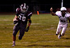 Matt Sterlina chased by Lansingburghs Anthony Walker at Burnt Hills-Ballston Lake high school football. Friday 09/06/13.  (Mike McMahon / The Record)