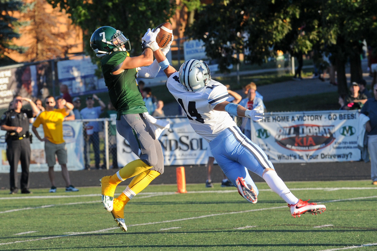 Medina's Dylan Fultz (7) goes up and over Kenston's Jack Porter (14) for a catch in the first quarter Friday night. ( JUDD SMERGLIA/GAZETTE)