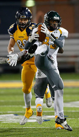 Medina's Demetrius Shannon makes an interception against Whitmer's Nick Whitcher during the fourth quarter that led to the winning drive. (RON SCHWANE / GAZETTE)