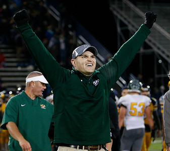 Medina head coach Dan Sutherland celebrates after beating Whitmer 38-31. (RON SCHWANE / GAZETTE)