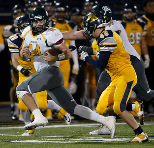 Medina's Jimmy Daw breaks away from Whitmer's Luke Walling during the fourth quarter. (RON SCHWANE / GAZETTE)