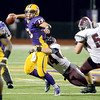 J.S.Carras/The Record  Burnt Hills' David Newell (44) tackles Troy quarterback Joe Germinerio (13) during second quarter of Section II class A semifinal high school football action Friday, November 1, 2013 at Troy High School in Troy, N.Y..