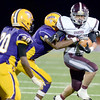 J.S.Carras/The Record  Burnt Hills ball carrier James Prezioso is tackled by Troy's Maurice Jones (20) and Alex Little (8) during second quarter of Section II class A semifinal high school football action Friday, November 1, 2013 at Troy High School in Troy, N.Y..
