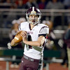 J.S.Carras/The Record  Burnt Hills quarterback John Clayton rolls out to pass against Troy during second quarter of Section II class A semifinal high school football action Friday, November 1, 2013 at Troy High School in Troy, N.Y..