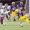 J.S.Carras/The Record  Burnt Hills ball carrier Danny Maynard (11) eyes Troy tackler Rayshawn Johnson (10) during second quarter of Section II class A semifinal high school football action Friday, November 1, 2013 at Troy High School in Troy, N.Y..