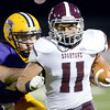 J.S.Carras/The Record  Burnt Hills Danny Maynard (11) is pushed out of bounds by Troy's Joe Germinerio (13) after making reception during third quarter of Section II class A semifinal high school football action Friday, November 1, 2013 at Troy High School in Troy, N.Y..
