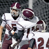 J.S.Carras/The Record  Burnt Hills' Packy Brown celebrates second quarter touchdown with teammates Brendan VanAllen (17) and Josh Quesada (24) during second quarter of Section II class A semifinal high school football action Friday, November 1, 2013 at Troy High School in Troy, N.Y..