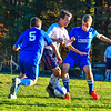 North Middlesex's Chris TenBroeck, center, is defended by Leominster's Conal McBride and John Gove. Nashoba Valley Voice/Ed Niser