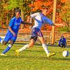 Leominster's Kelvin Melma chases North Middlesex defender Jake Fitzgerald. Nashoba Valley Voice/Ed NiIser