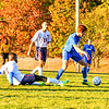 Leominster's Facundo Cotto advances the ball past North Middlesex's Daniel Offor. Nashoba Valley Voice/Ed Niser